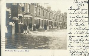 This terrace of houses in Wanstead Park Road, which backs on to the River Roding, were also flooded out. The postcard was written on July 1st, 1903