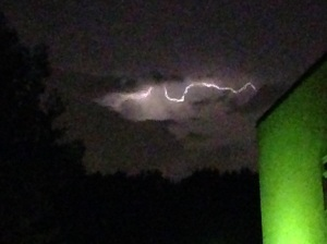 This grainy image shows distant lightning illuminating a cloud. The storm was centred over St Albans