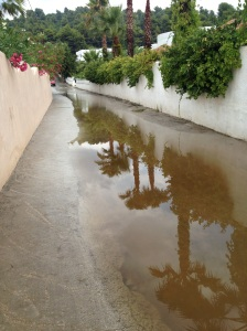 Water from the hills above turned local roads into rivers