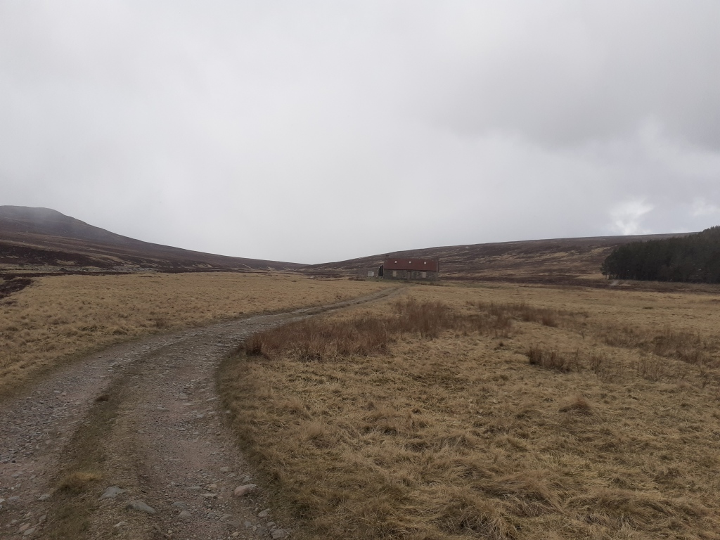 A bothy seen from where the track splits. Turn left for Blair Atholl, right for Glen Feshie