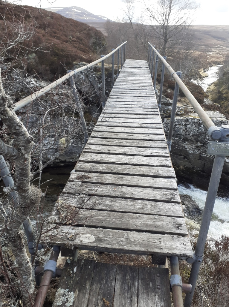 A rickety bridge spans the River Eidart - some of the wooden slats have seen better days